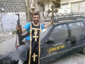 syrian-insurgent-with-cross-and-epitrachelion-looted-from-church